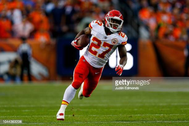 Running back Kareem Hunt of the Kansas City Chiefs rushes in the open field against the Denver Broncos in the first quarter of a game at Broncos...