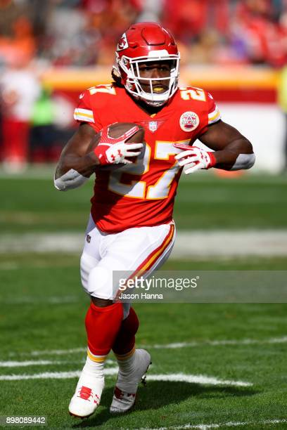 Running back Kareem Hunt of the Kansas City Chiefs rushes the ball in the backfield during the first quarter against the Miami Dolphins at Arrowhead...