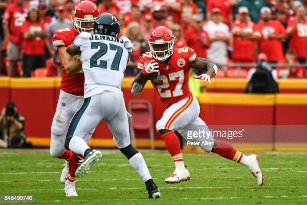 Running back Kareem Hunt of the Kansas City Chiefs rushes the ball with teammate Travis Kelce blocking strong safety Malcolm Jenkins of the...