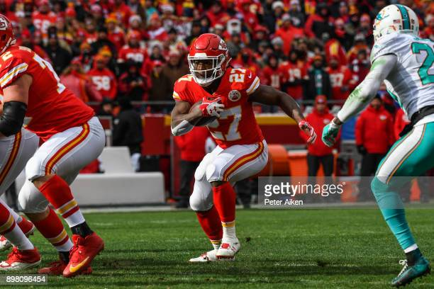 Running back Kareem Hunt of the Kansas City Chiefs rushes through a hole during the first quarter of the game against the Miami Dolphins at Arrowhead...