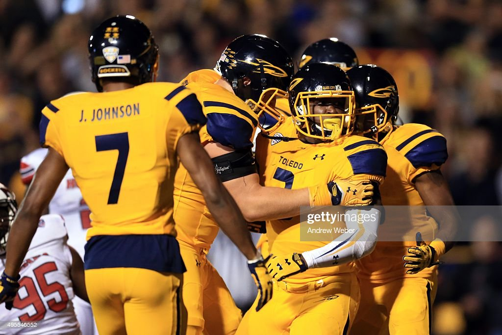 Running back Kareem Hunt #3 of the Toledo Rockets celebrates after scoring a touchdown during the first quarter against the Northern Illinois Huskies at Glass Bowl on November 3, 2015 in Toledo, Ohio.