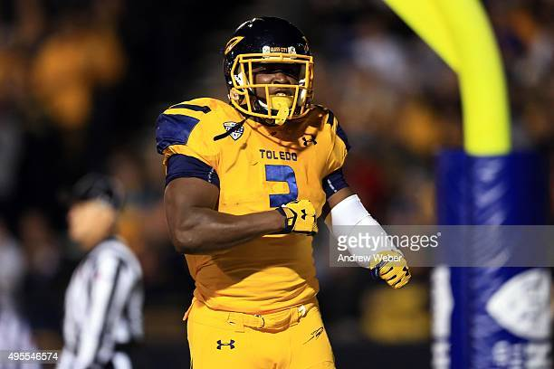 Running back Kareem Hunt of the Toledo Rockets celebrates after scoring a touchdown during the first quarter against the Northern Illinois Huskies at...