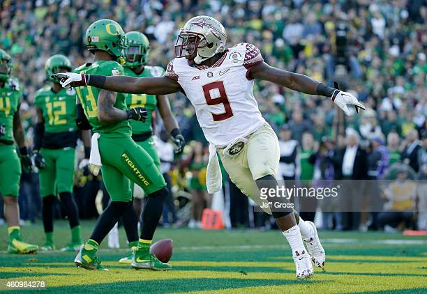 Running back Karlos Williams of the Florida State Seminoles reacts after scoring against the Oregon Ducks in the second quarter of the College...