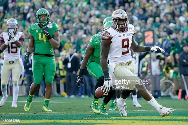 Running back Karlos Williams of the Florida State Seminoles scores on a 10yard run against the Oregon Ducks in the second quarter of the College...