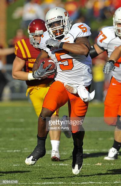 Running back Keith Toston of the Oklahoma State Cowboys rushes for yards against the Iowa State Cyclones in the first half of play at Jack Trice...