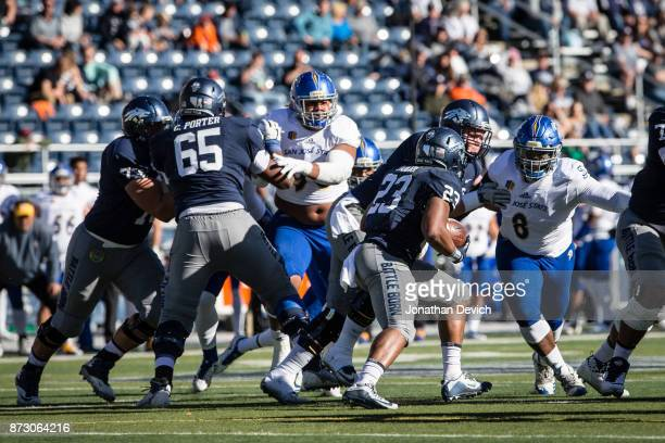 Running back Kelton Moore of the Nevada Wolf Pack tries to run the ball through the defensive line of the San Jose State Spartans at Mackay Stadium...