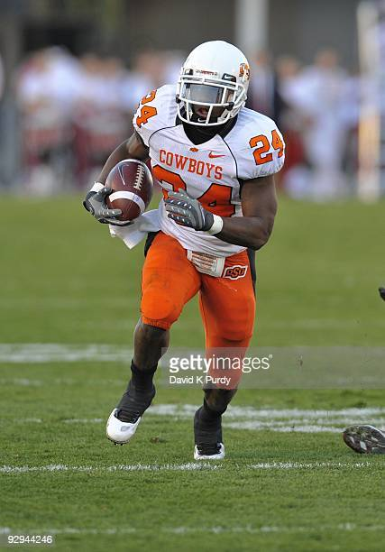 Running back Kendall Hunter of the Oklahoma State Cowboys rushes for yards up the middle against the Iowa State Cyclones in the second half of play...