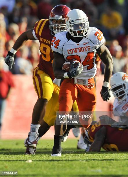 Running back Kendall Hunter of the Oklahoma State Cowboys rushes for yards up the middle past defensive tackle Stephen Ruempolhamer of the Iowa State...