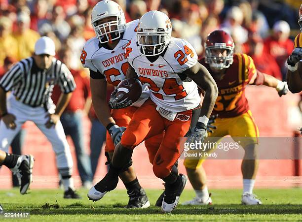 Running back Kendall Hunter of the Oklahoma State Cowboys rushes for yards up the middle against the Iowa State Cyclones in the first half of play at...