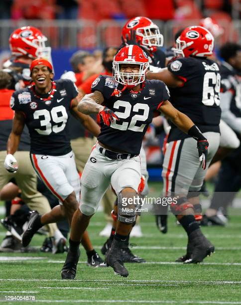Running back Kendall Milton of the Georgia Bulldogs celebrates after the go-ahead field goal during the Chick-fil-A Peach Bowl against the Cincinnati...