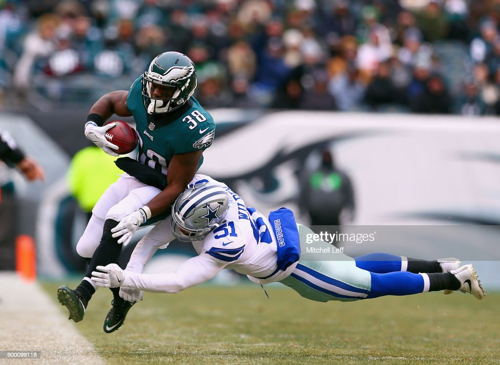 running back Kenjon Barner #38 of the Philadelphia Eagles is pushed out of bounds by outside linebacker Kyle Wilber #51 of the Dallas Cowboys during the second quarter of the game at Lincoln Financial Field on December 31, 2017 in Philadelphia, Pennsylvania.