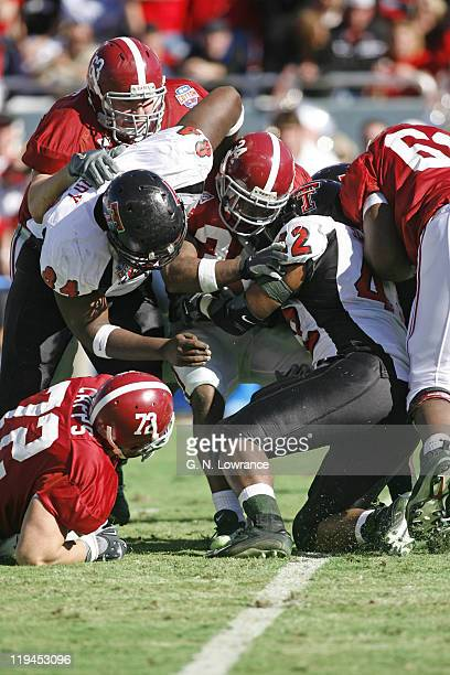 Running back Kenneth Darby of the Alabama Crimson Tide is swarmed by defenders during a 1310 victory over the Texas Tech Red Raiders at the ATT...