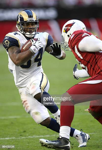 Running back Kenneth Darby of the St Louis Rams carries the ball against linebacker Karlos Dansby of the Arizona Cardinals on December 27 2009 at...