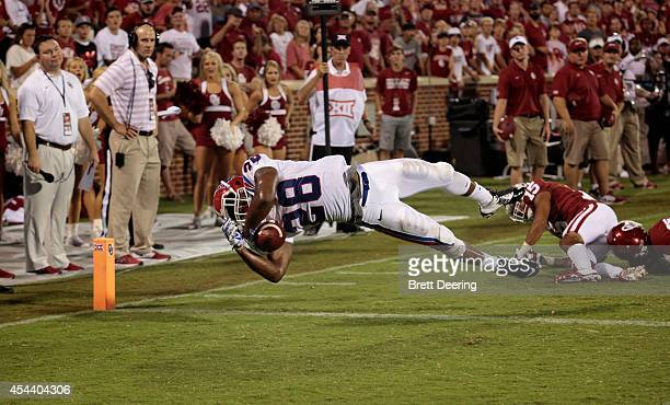 Running back Kenneth Dixon of the Louisiana Tech Bulldogs dives for a touchdown against the Oklahoma Sooners August 30 2014 at Gaylord FamilyOklahoma...