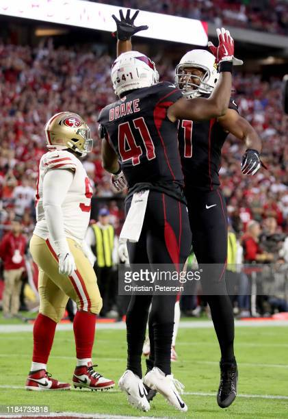 Running Back Kenyan Drake of the Arizona Cardinals and teammate Larry Fitzgerald of the Arizona Cardinals celebrate his touchdown in the first...