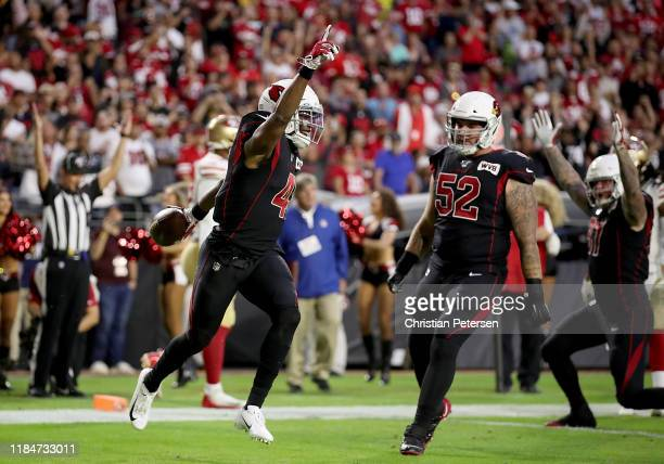 Running Back Kenyan Drake of the Arizona Cardinals and teammates celebrate his touchdown in the first quarter over the San Francisco 49ers at State...