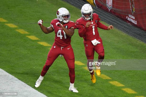 Running back Kenyan Drake of the Arizona Cardinals celebrates with quarterback Kyler Murray after Murray's touchdown during the second half against...