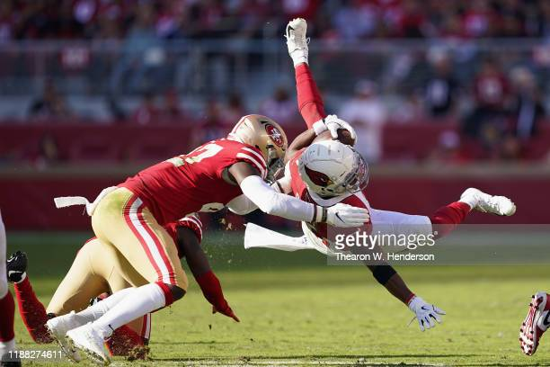 Running back Kenyan Drake of the Arizona Cardinals is tackled as he rushes the football against the San Francisco 49ers during the first half of the...
