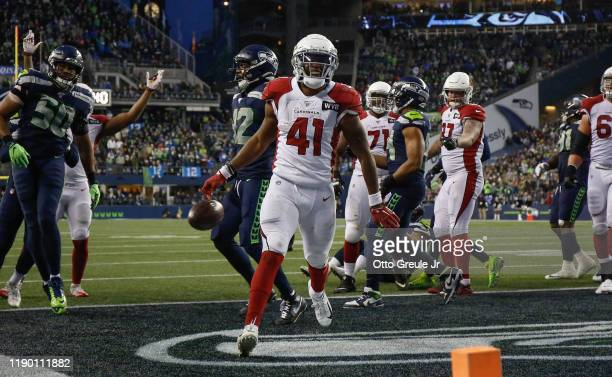 Running back Kenyan Drake of the Arizona Cardinals rushes for a touchdown in the fourth quarter against the Seattle Seahawks at CenturyLink Field on...