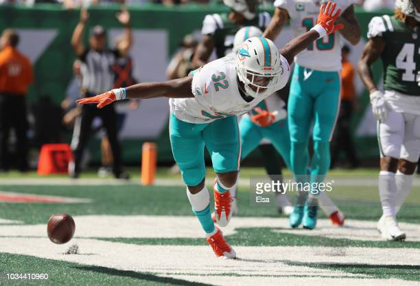 Running back Kenyan Drake of the Miami Dolphins celebrates his touchdown against the New York Jets during the first quarter at MetLife Stadium on...