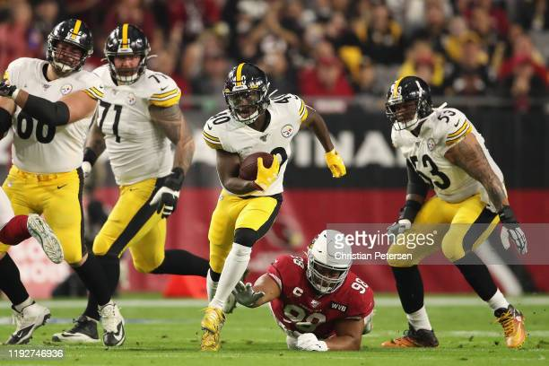 Running back Kerrith Whyte of the Pittsburgh Steelers rushes the football past defensive tackle Corey Peters of the Arizona Cardinals during the...