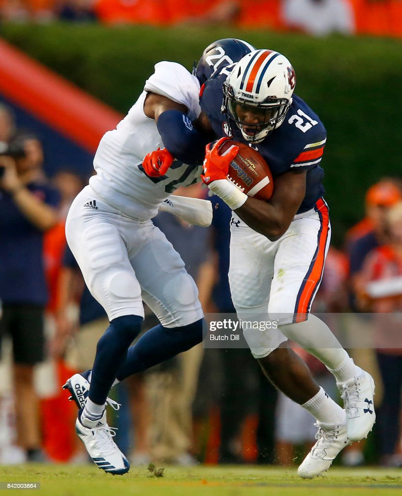 Running back Kerryon Johnson #21 of the Auburn Tigers carries the ball as he is tackled by cornerback Kindle Vildor #20 of the Georgia Southern Eagles during the first quarter of an NCAA college football game at Jordan Hare Stadium on Saturday, September 2, 2017 in Auburn, Alabama.