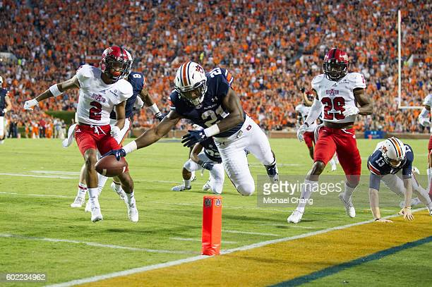 Running back Kerryon Johnson of the Auburn Tigers dives into the end zone for a touchdown during their game against the Arkansas State Red Wolves at...
