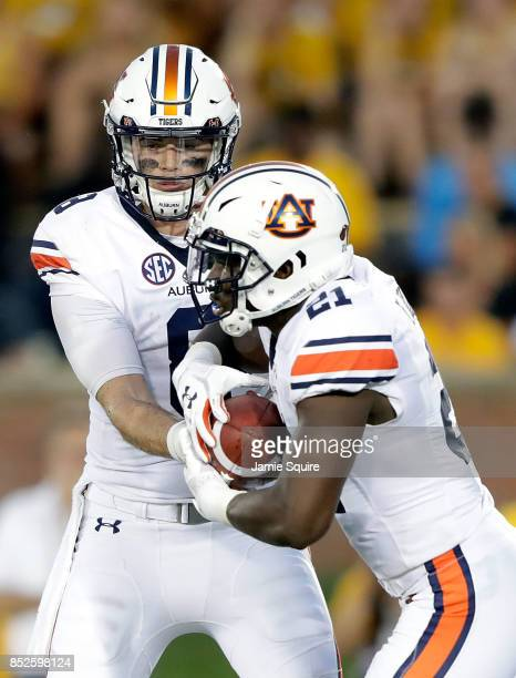 Running back Kerryon Johnson of the Auburn Tigers receives a handoff by quarterback Jarrett Stidham during the game against the Missouri Tigers at...