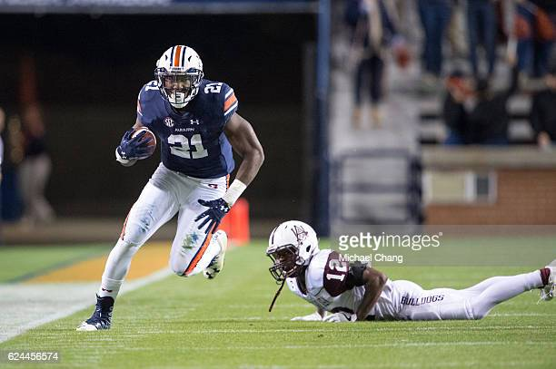 Running back Kerryon Johnson of the Auburn Tigers runs the ball by defensive back Devonte Simon of the Alabama AM Bulldogs at JordanHare Stadium on...