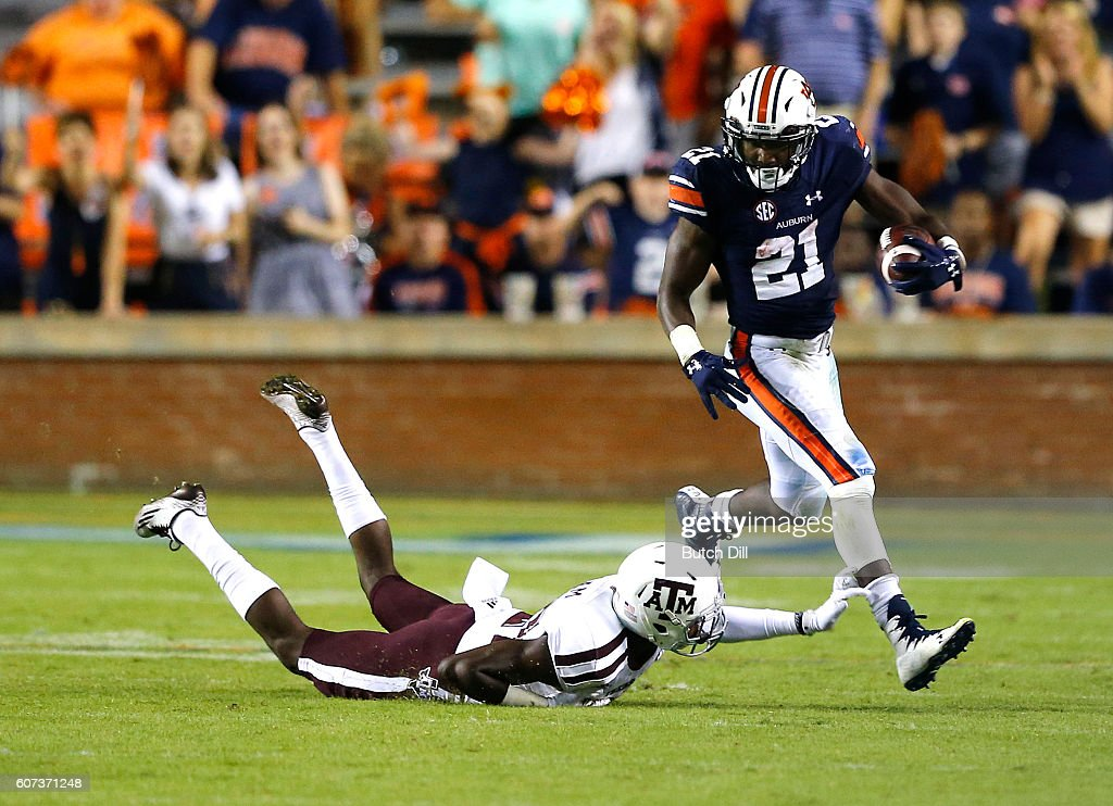 Running back Kerryon Johnson #21 of the Auburn Tigers tries to get around defensive back Charles Oliver #21 of the Texas A&M Aggies during the second half of an NCAA college football game on September 17, 2016 in Auburn, Alabama.