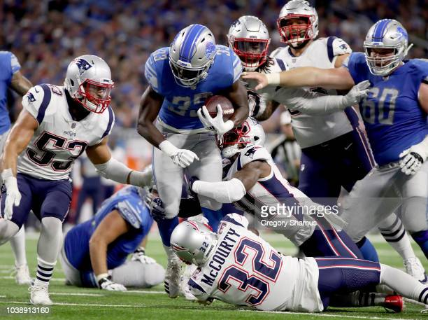 Running back Kerryon Johnson of the Detroit Lions runs for yardage against the New England Patriots during the first half at Ford Field on September...