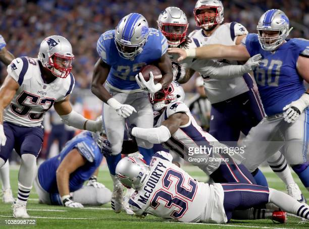 Running back Kerryon Johnson of the Detroit Lions runs for yardage against the New England Patriots at Ford Field on September 23 2018 in Detroit...