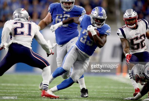Running back Kerryon Johnson of the Detroit Lions runs for yardage against Duron Harmon of the New England Patriots during the second half at Ford...