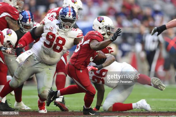 Running back Kerwynn Williams of the Arizona Cardinals carries the football against the New York Giants in the second half at University of Phoenix...