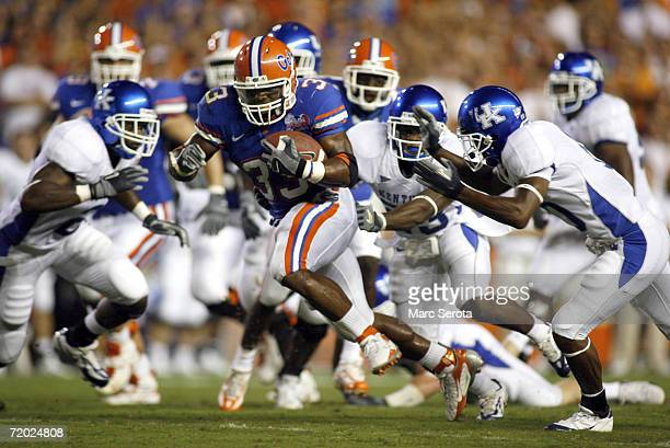 Running back Kestahn Moore of the University of Florida Gators carries the ball against the University of Kentucky Wildcats during the game at Ben...