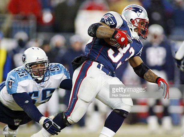 Running back Kevin Faulk of the New England Patriots gets away from linebacker Brad Kassell of the Tennessee Titans during the AFC divisional...
