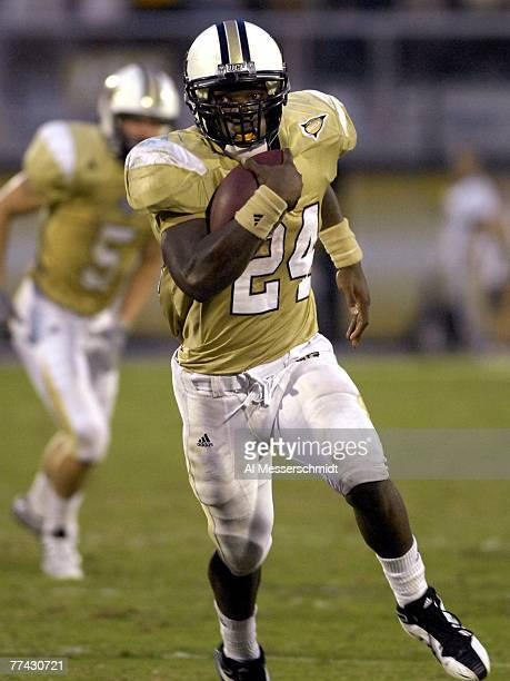 Running back Kevin Smith of the University of Central Florida Golden Knights rushes upfield against the Tulsa Golden Hurricane at Bright House...