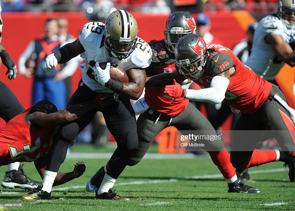Running back Khiry Robinson #29 of the New Orleans Saints carries the ball in the third quarter against the Tampa Bay Buccaneers at Raymond James Stadium on December 28, 2014 in Tampa, Florida.