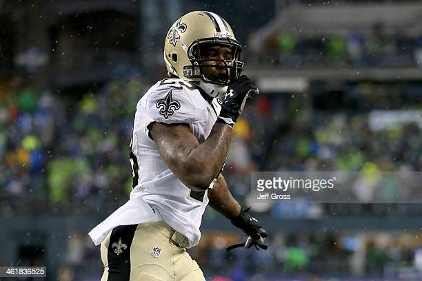 Running back Khiry Robinson of the New Orleans Saints celebrates after scoring on a one-yard touchdown run in the fourth quarter against the Seattle...