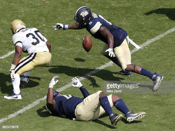 Running back KirVonte Benson of the Georgia Tech Yellow Jackets fumbles in the second half during the game against the the Pittsburgh Panthers at...