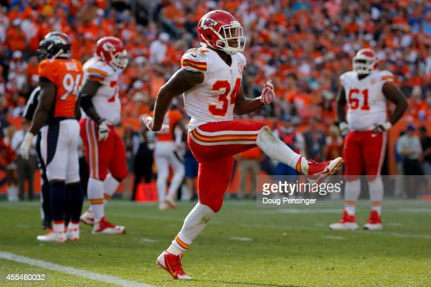 Running back Knile Davis of the Kansas City Chiefs celebrates a fourth quarter touchdown against the Denver Broncos during a game at Sports Authority...