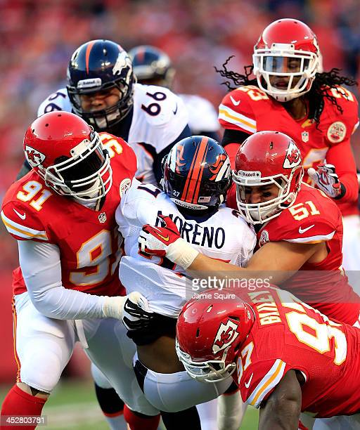 Running back Knowshon Moreno of the Denver Broncos is stopped by outside linebacker Tamba Hali linebacker Frank Zombo defensive end Allen Bailey and...