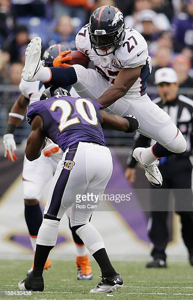 Running back Knowshon Moreno of the Denver Broncos jumps over free safety Ed Reed of the Baltimore Ravens while rushing the ball during the first...