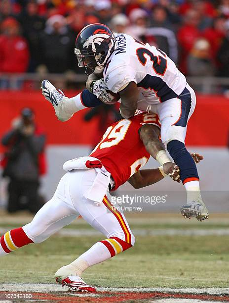 Running back Knowshon Moreno of the Denver Broncos leaps over safety Eric Berry of the Kansas City Chiefs in a game at Arrowhead Stadium on December...