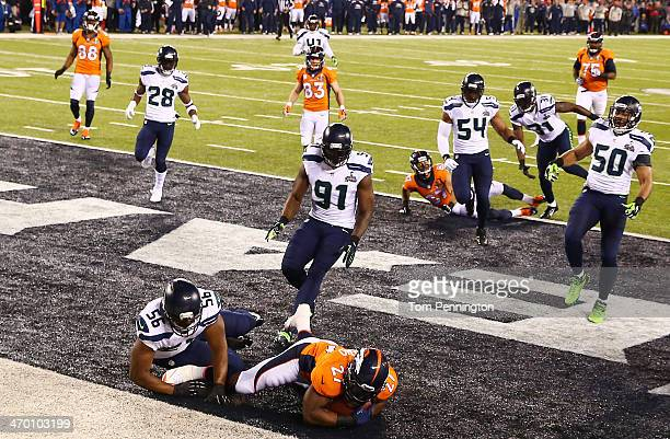 Running back Knowshon Moreno of the Denver Broncos recovers the ball in the endzone for a safety against the Seattle Seahawks during the first...