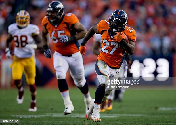 Running back Knowshon Moreno of the Denver Broncos runs for a 35yard touchdown after making a reception during the fourth quarter against the...