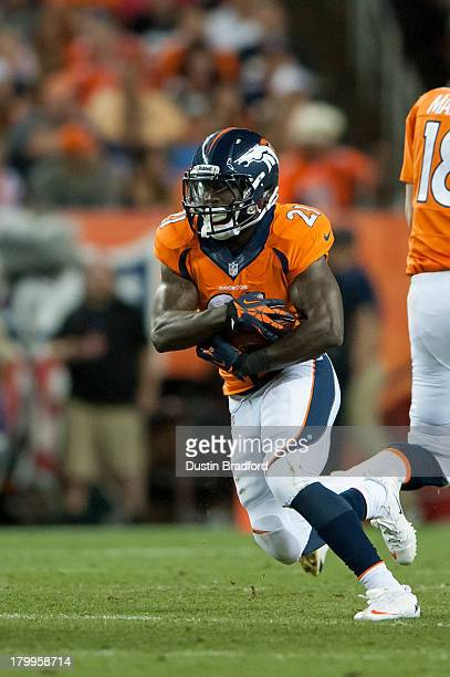 Running back Knowshon Moreno of the Denver Broncos rushes against the Baltimore Ravens during the game at Sports Authority Field at Mile High on...