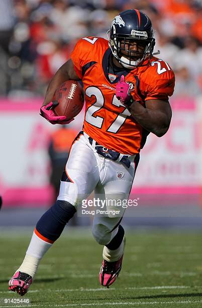 Running back Knowshon Moreno of the Denver Broncos rushes against the Dallas Cowboys during NFL action at Invesco Field at Mile High on October 4...