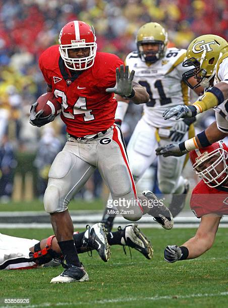 Running back Knowshon Moreno of the Georgia Bulldogs breaks through the line of scrimmage during a rushing attempt during the game against the...