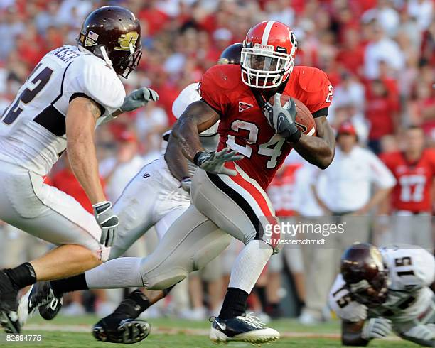 Running back Knowshon Moreno of the Georgia Bulldogs rushes upfield against the Central Michigan Chippewas at Sanford Stadium on September 6 2008 in...